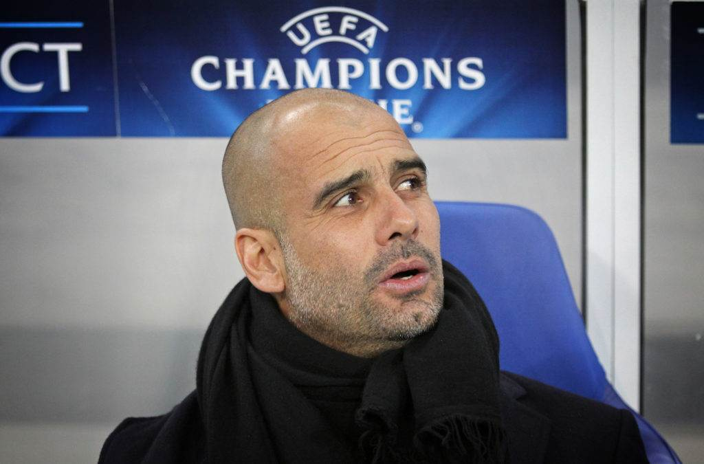 LVIV UKRAINE - FEBRUARY 17 2015: FC Bayern Munich manager Josep Guardiola looks on during UEFA Champions League game against Shakhtar Donetsk at Arena Lviv stadium