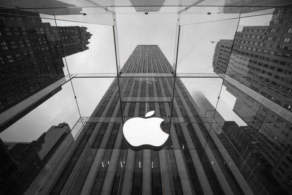 NEW YORK USA - May 04 2016: Apple Store logo at the entrance to the Apple Store on Fifth Avenue New York. Apple Store cube on 5th Avenue on a cloudy rainy day