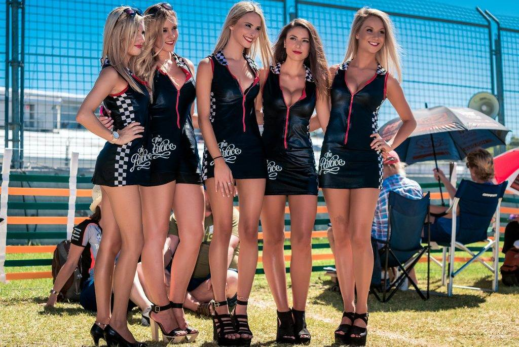 Adelaide South Australia - March 01 2014: Grid girls are interacting with visitors at Clipsal 500 V8 Supercars