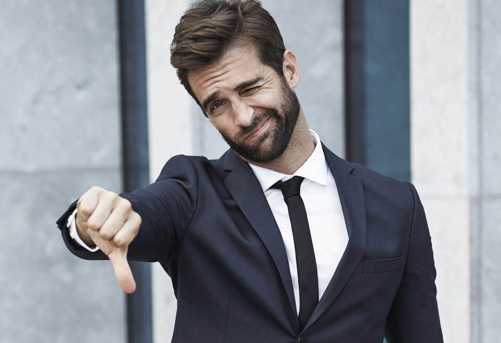 Handsome Businessman saying 'No' with a thumbs down