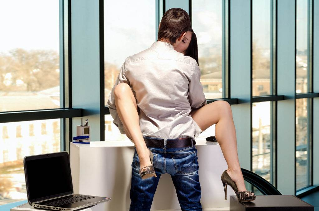 Young business couple are having sex in the workplace