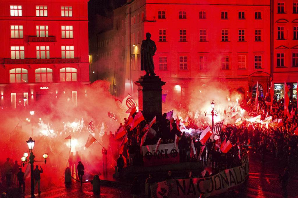 KRAKOW, POLAND - NOV 11, 2015: Protesters march through center of city. About 3.000 people took part in March of Free Poland. Participants chanted slogans Neither EU nor NATO, Poland only for Poles.