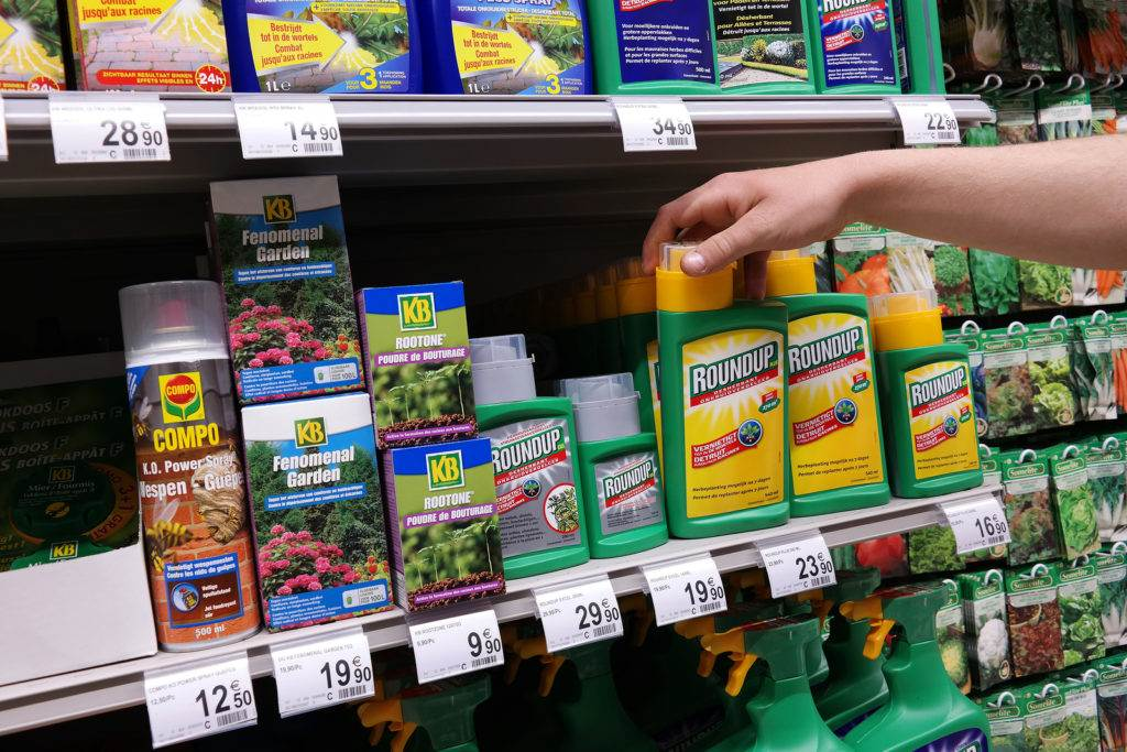 MALMEDY, BELGIUM - MAY 7: Shelves with a variety of Herbicides in a Carrefour Hypermarket. Roundup is a brand-name of an herbicide made by Monsanto. Photo taken on May 7, 2015 in Malmedy, Belgium