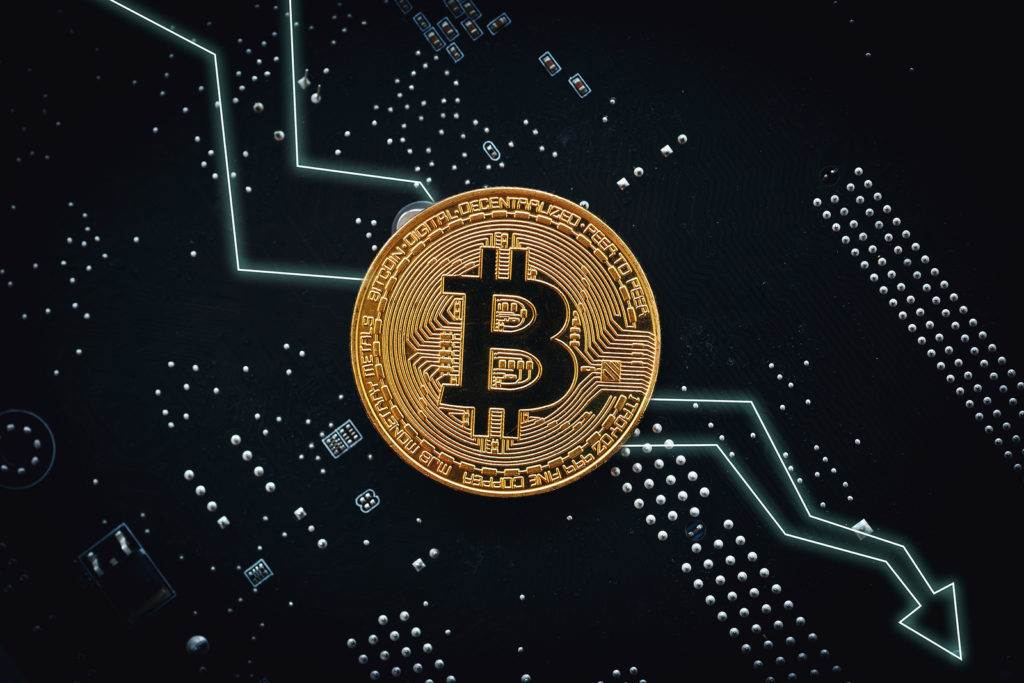 Bitcoin fall down. Golden Bitcoin coin - symbol of crypto currency and arrow down on tech background. Virtual money risk, crisis and collapse concept
