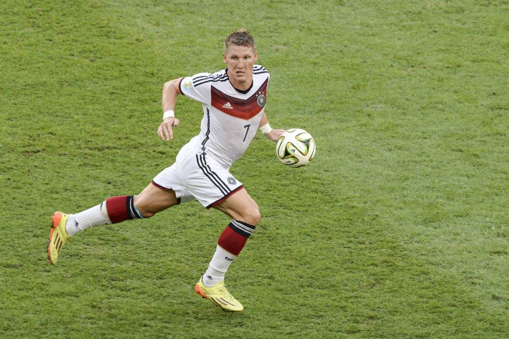 RIO DE JANEIRO BRAZIL - July 13 2014: Bastian SCHWEINSTEIGER of Germany kicks the ball during the 2014 World Cup Final game between Argentina and Germany at Maracana Stadium.