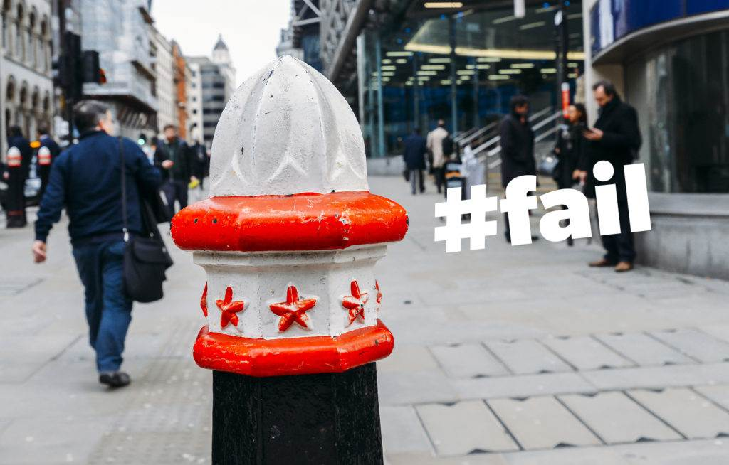 London, UK- Mar 13, 2018: Selective focus on a bollard in the City of London, with City workers in the background