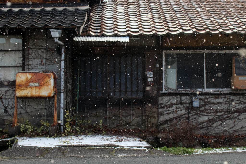 The old abandoned Japanese house during winter (snowing). Taken in February 2018.