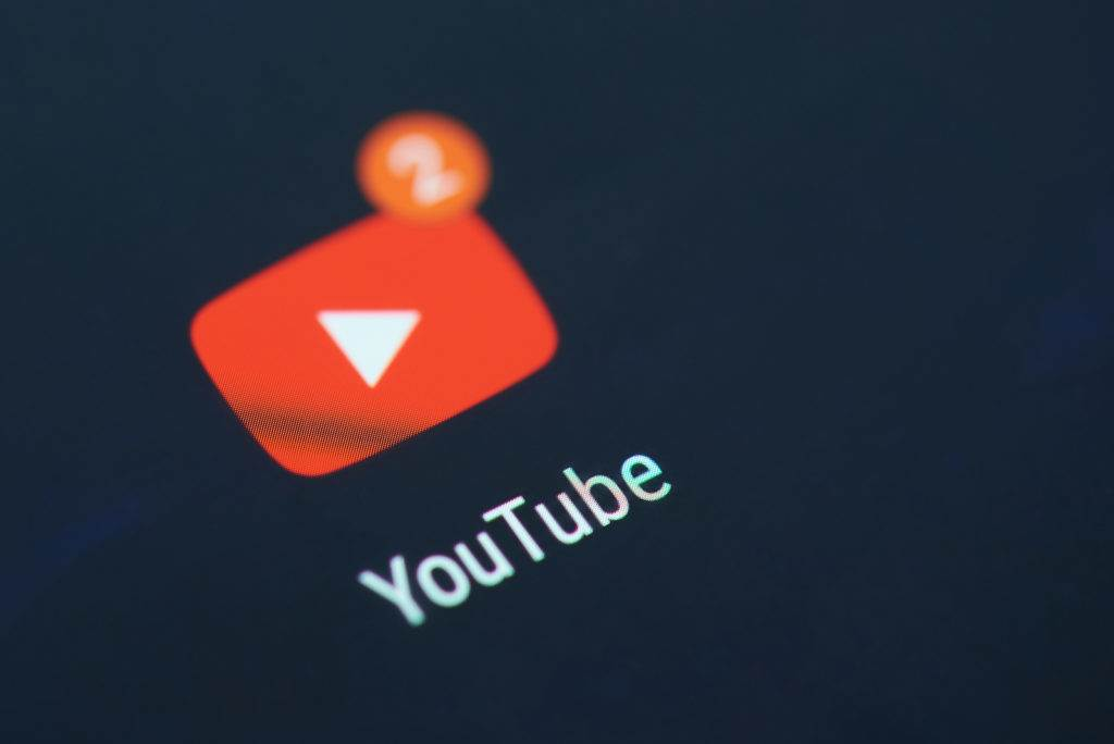 New york, USA - December 12, 2017: Youtube application icon on smartphone screen close-up with new videos on subscriptions