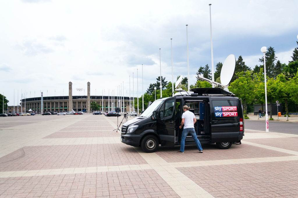 BERLIN, GERMANY - MAY 15 2018: Sky Sports television production truck stands in front of Olympic stadium from 1936 on May 15, 2018 in Berlin, Germany.