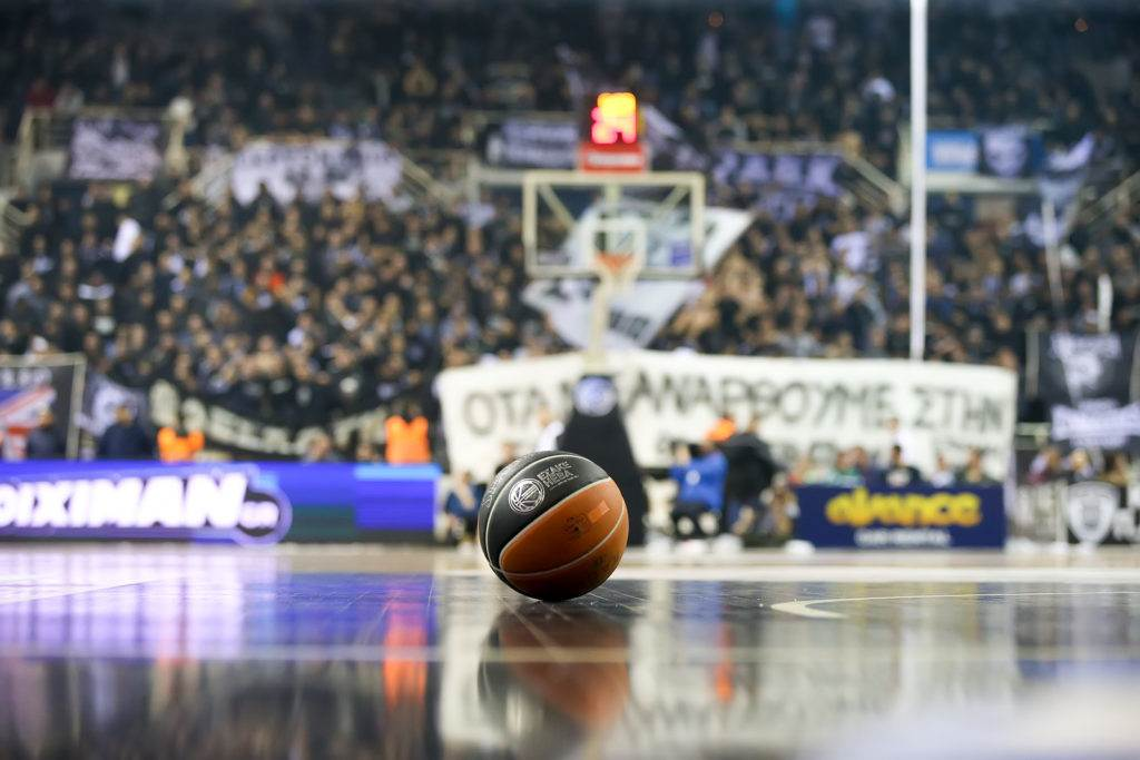 Thessaloniki Greece February 5 2017: ball in the foreground and blurred crowd in backraount during the Greek Basket League game Paok vs Aris at PAOK sports arena.