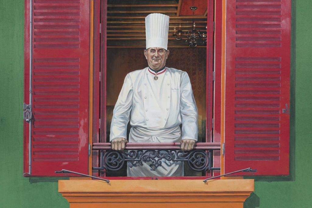 Lyon, France - January 27, 2016: Facade of the restaurant Paul Bocuse with his portrait. Paul Bocuse, 3 stars at the Michelin guide, is a famous french chef in the world and based in Lyon, France