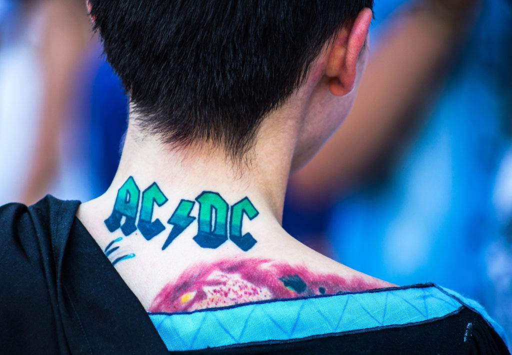 Genoa Italy, September 2016. ACDC tattoo on the back of a young girl / tattoo/ Band/ girl/ cosplay